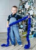 Boy with Christmas tree Stock Photos