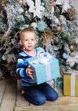 Boy with Christmas tree Stock Photo