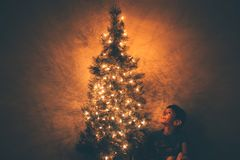 Boy Beside Christmas Tree Illustration Stock Photography