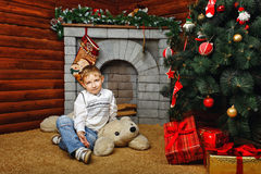Boy and Christmas tree Stock Image