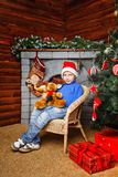 Boy and Christmas tree Royalty Free Stock Photo