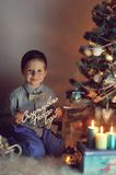 Boy and Christmas tree Royalty Free Stock Images