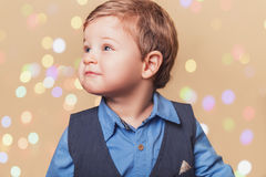 Boy with christmass lights bokeh Stock Photo