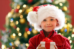 Boy with Chritmas gift Royalty Free Stock Photos