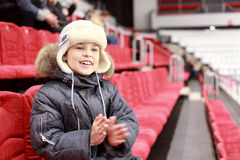 Boy claps one's hands on hockey match Royalty Free Stock Photo