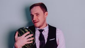 A man and a watermelon / Boy in classic suit with a watermelon. Boy in classic suit with a watermelon / A man and a watermelon n Stock Photography