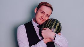 A man and a watermelon / Boy in classic suit with a watermelon. Boy in classic suit with a watermelon / A man and a watermelon n Royalty Free Stock Photos