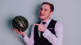 A man and a watermelon / Boy in classic suit with a watermelon. Boy in classic suit with a watermelon / A man and a watermelon n Stock Image