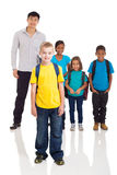 Boy classmates teacher. Cute school boy standing in front of classmates and teacher on white background royalty free stock image