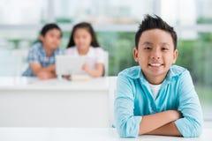 Boy in classroom Royalty Free Stock Photo