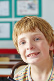 Boy in classroom smiling Royalty Free Stock Photo