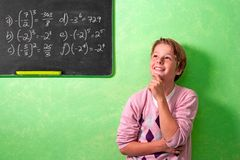 Boy in classroom with wondering expression Stock Photos