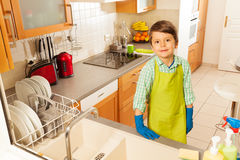 Boy cleaned all the dishes in kitchen sink Stock Images
