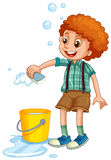 Boy cleaning with sponge Stock Photo