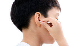 Boy cleannin ear by cotton bud Stock Photo