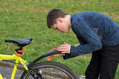 Boy cleans bicycle Royalty Free Stock Images
