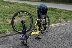 Boy cleans bike Stock Photos