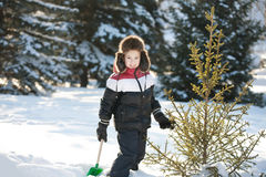 The boy cleans snow Royalty Free Stock Photography
