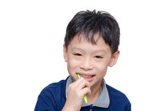 Boy cleansing teeth by toothbrush Stock Images