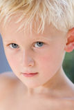 Boy with Clear Eyes and Beautiful Skin. Blond Boy Close-up portrait: Selective Focus on Eyes. outdoors, shirtless, 4-7 years Stock Image
