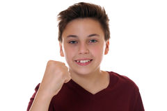 Boy with clenched fist for success while winning. Isolated on a white background Stock Images