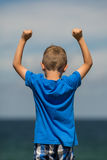 Boy with clenched fists. Young caucasian boy in Denmark on a summer day Stock Photos
