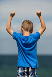 Boy with clenched fists. Young caucasian boy in Denmark on a summer day Stock Photography