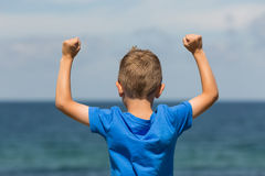 Boy with clenched fists. Young caucasian boy in Denmark on a summer day Stock Images