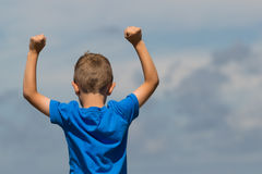 Boy with clenched fists. Young caucasian boy in Denmark on a summer day Royalty Free Stock Image
