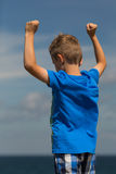 Boy with clenched fists. Young caucasian boy in Denmark on a summer day Royalty Free Stock Photos