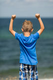 Boy with clenched fists Stock Images