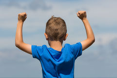 Boy with clenched fists Stock Photo