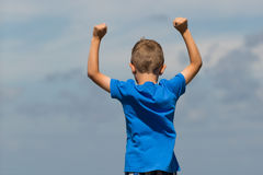 Boy with clenched fists Royalty Free Stock Images