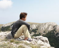Boy on the cliff Royalty Free Stock Photography