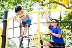 Boy climb on the rope fence Stock Photos