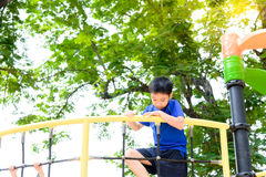 Boy climb on the rope fence Royalty Free Stock Images