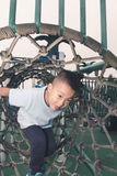 Boy climb rope tunnel Royalty Free Stock Photo