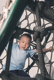 Boy climb rope tunnel Royalty Free Stock Photos