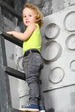 A boy climbed up the ladder Royalty Free Stock Photos