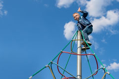 The boy climbed up on the top Royalty Free Stock Image