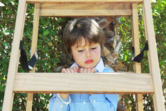 The boy climbed up a wooden sliding ladder Stock Photography