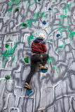 Boy climber on a wall Stock Photography
