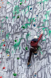 Boy climber on a wall Royalty Free Stock Image
