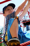Boy climbing. On red ropes Stock Photography