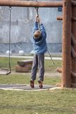 Boy climbing Stock Images