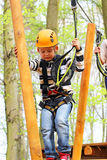 Boy in a climbing adventure activity park Stock Images