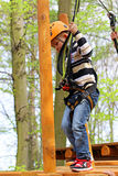 Boy in a climbing adventure activity park Royalty Free Stock Image