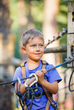 Boy in a climbing adventure park Stock Photos