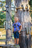 Boy in a climbing adventure park Stock Images