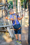 Boy in a climbing adventure park Stock Photo